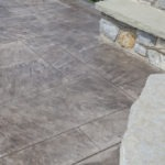 stamped concrete patio and fireplace
